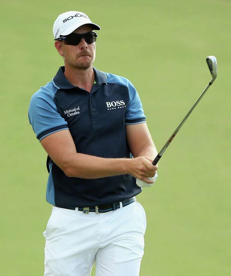 DUBAI, UNITED ARAB EMIRATES - NOVEMBER 14:  Henrik Stenson of Sweden hits his second shot on the 12th hole during the first round of the DP World Tour Championship, Dubai on the Earth Course at Jumeirah Golf Estates on November 14, 2013 in Dubai, United Arab Emirates.  (Photo by Andrew Redington/Getty Images) ORG XMIT: 181933897 Photo: Andrew Redington / 2013 Getty Images