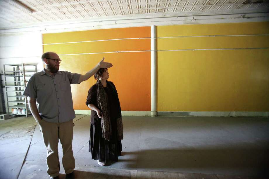 Erik Bosse and Laurie Dietrich with the Jump-Start Performance Co. tour the company's new space on Fredericksburg Road. Photo: Helen L. Montoya / San Antonio Express-News