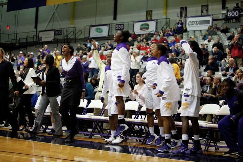 UAlbany teammates cheer after scoring during the womenOs college basketball game against Marist at t
