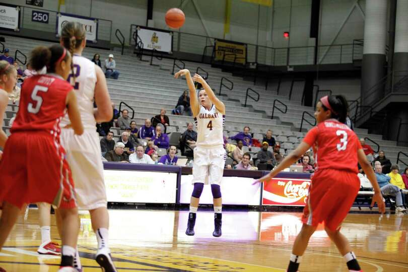 UAlbanyOs Sarah Royals shoots a long jump shot during the womenOs college basketball game against Ma