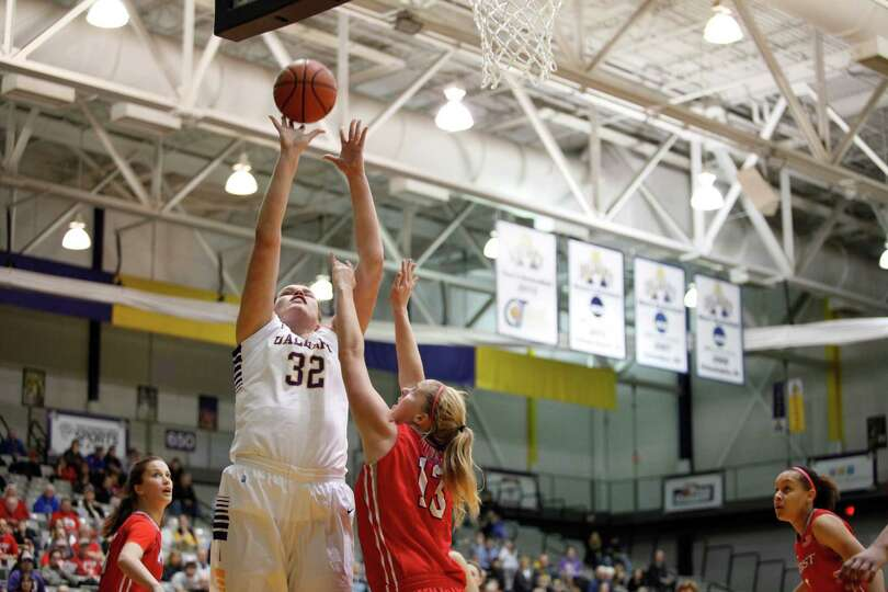 UAlbanyOs Megan Craig takes the ball in for a layup during the womenOs college basketball game again