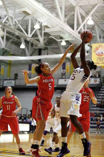 UAlbanyOs Shereesha Richards attempts a shot over Marist defender Sydney Coffey during the womenOs c