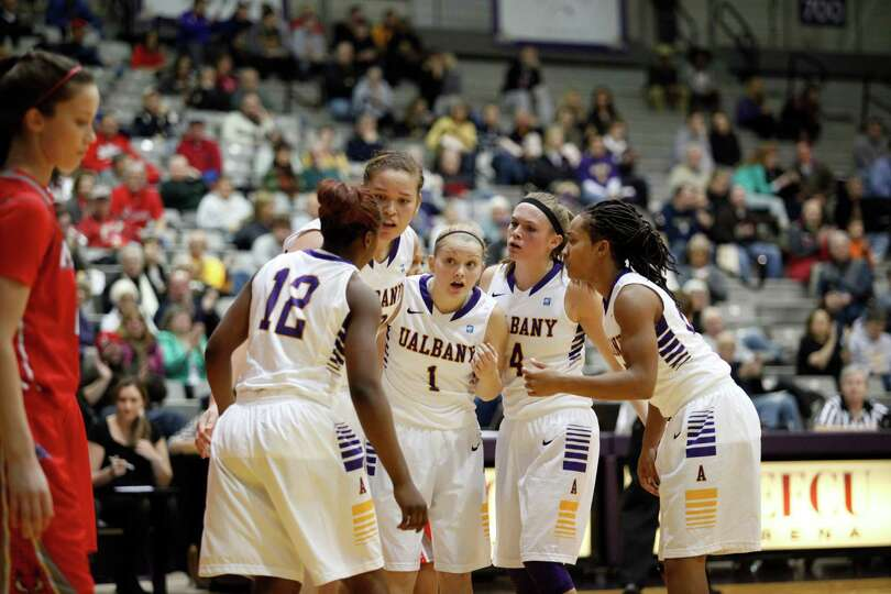 UAlbany players huddle up during the womenOs college basketball game against Marist at the SEFCU Are