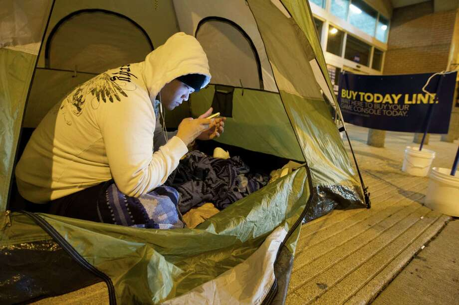 Tri Nguyen camped out since 6 a.m. Thursday in Sugar Land to be first at Best Buy to buy the PlayStation 4 at 12:01 a.m. Friday. Photo: J. Patric Schneider, Freelance / © 2013 Houston Chronicle
