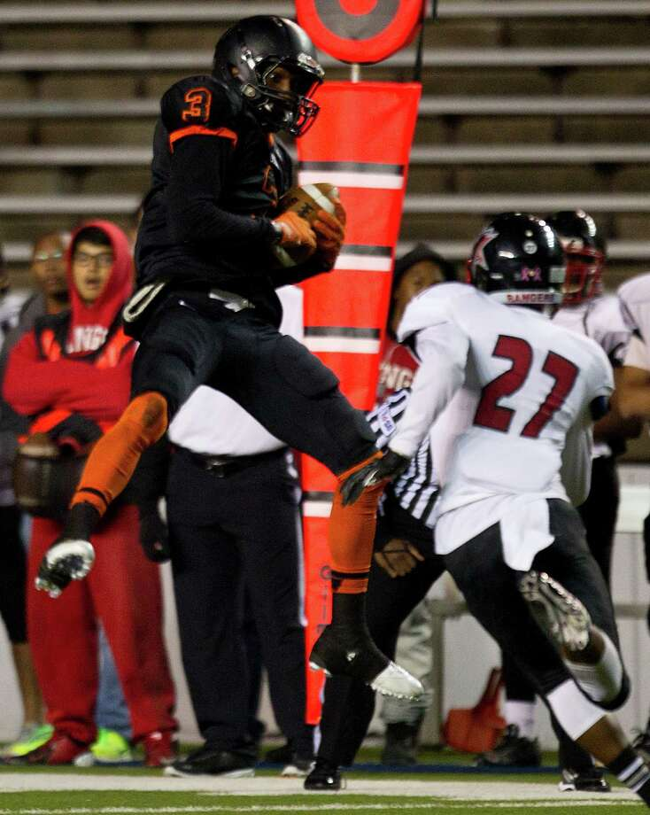 Texas City wide receiver Armanti Foreman (3) leaps to make a catch over Rosenberg Terry defensive back Drake James (27) during the first half of a Class 4A Bi-district high school playoff football game at Rice Stadium on Thursday, Nov. 14, 2013, in Houston. Photo: Brett Coomer, Houston Chronicle / © 2013  Houston Chronicle