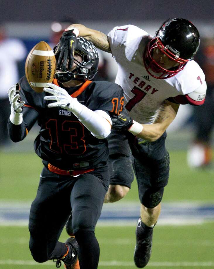 Rosenberg Terry defensive back Neilson Williams (7) breaks up a pass intended for Texas wide receiver Tres Rodriguez (13) during the first half of a Class 4A Bi-district high school playoff football game at Rice Stadium on Thursday, Nov. 14, 2013, in Houston. Photo: Brett Coomer, Houston Chronicle / © 2013  Houston Chronicle