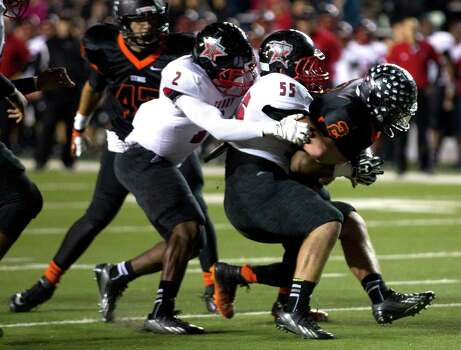 Rosenberg Terry's Norris Palmer (2) and Zach Garcia (55) tackle Texas City's Donald Lynch (2) during the first half of a Class 4A Bi-district high school playoff football game at Rice Stadium on Thursday, Nov. 14, 2013, in Houston. Photo: Brett Coomer, Houston Chronicle / © 2013  Houston Chronicle