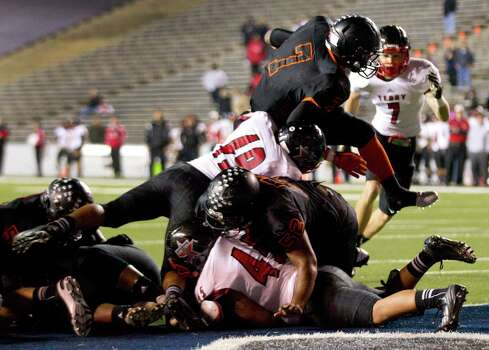 Texas City running back D'Onta Foreman (7) dives over the goal one for a 1-yard touchdown run against Rosenberg Terry during the first half of a Class 4A Bi-district high school playoff football game at Rice Stadium on Thursday, Nov. 14, 2013, in Houston. Photo: Brett Coomer, Houston Chronicle / © 2013  Houston Chronicle