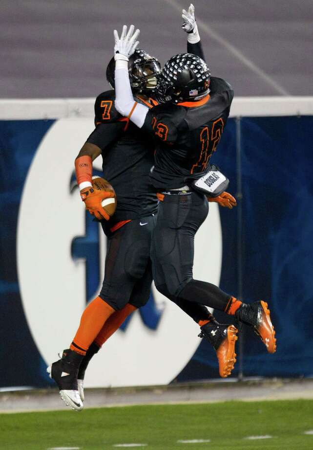 Texas City running back D'Onta Foreman (7) celebrates his 81-yard touchdown run against Rosenberg Terry with teammate Tres Rodriguez (13) during the first half of a Class 4A Bi-district high school playoff football game at Rice Stadium on Thursday, Nov. 14, 2013, in Houston. Photo: Brett Coomer, Houston Chronicle / © 2013  Houston Chronicle