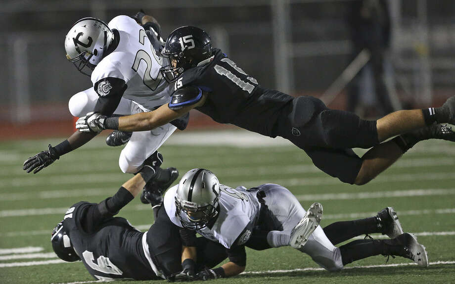 Steele's Marcos Gutierrez makes a flying tackle on Clark's William Young at Comalander Stadium, where the Knights' defense held the Cougars in check after allowing 111 yards in their first two possessions. Photo: Tom Reel / San Antonio Express-News
