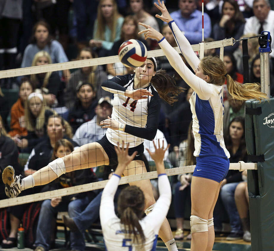 Abby Buckingham (left) and Churchill survived another five-set match against New Braunfels. Photo: Tom Reel / San Antonio Express-News