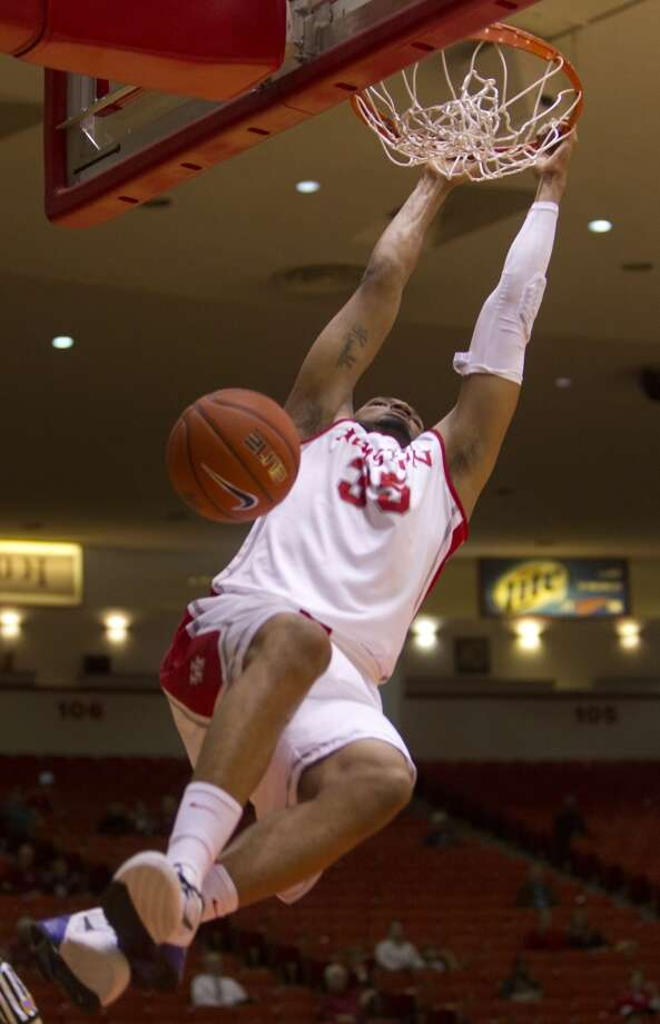 Houston Cougars forward TaShawn Thomas dunks during the first half of their matchup against the University of Texas San Antonio Road Runners in the Hofheinz Pavillion at the University of Houston, Thursday, Nov. 14, 2013, in Houston. (Cody Duty / Houston Chronicle) Photo: Cody Duty, Houston Chronicle