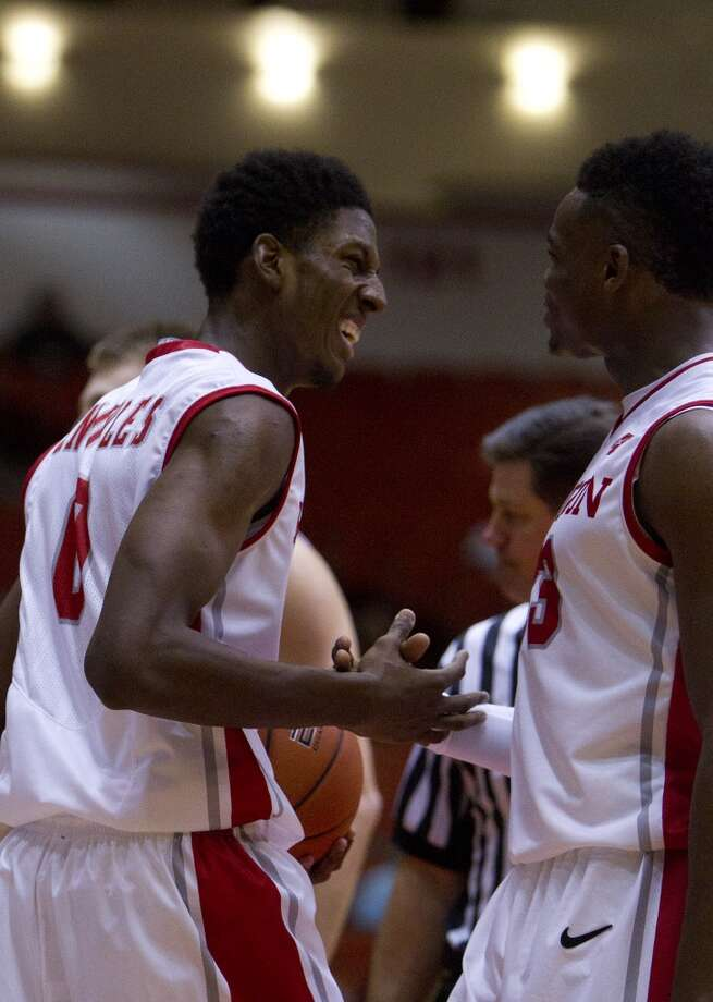 Houston Cougars forward Danrad Knowles, left, smiles as he's congratulated by guard Danuel House, right, after drawing a foul during the second half of their matchup against the University of Texas San Antonio Road Runners in the Hofheinz Pavillion at the University of Houston, Thursday, Nov. 14, 2013, in Houston. Houston won 80-62. (Cody Duty / Houston Chronicle) Photo: Cody Duty, Houston Chronicle