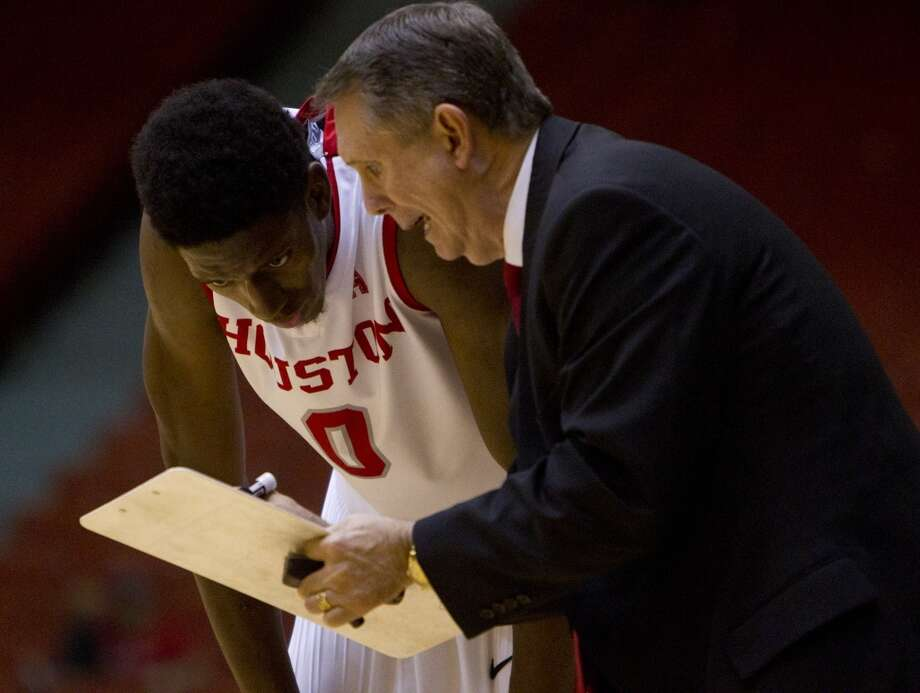 Houston Cougars forward Danrad Knowles, left, and Houston Cougars head coach James Dickey, right, talk on the sidelines during the second half of their matchup against the University of Texas San Antonio Road Runners in the Hofheinz Pavillion at the University of Houston, Thursday, Nov. 14, 2013, in Houston. (Cody Duty / Houston Chronicle) Photo: Cody Duty, Houston Chronicle