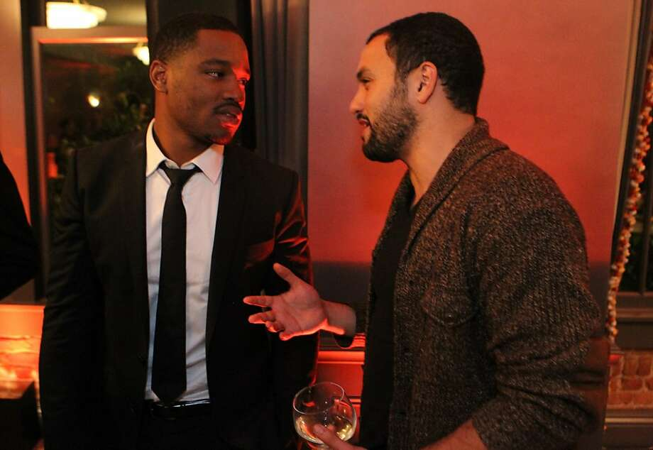 """Fruitvale Station director Ryan Coogler, left, and Karim Amer, producer of """"The Square"""", talk at the San Francisco Film Society's Inaugural Fall Celebration in San Francisco on Thursday, Nov. 14, 2013. Photo: Mathew Sumner, Special To The Chronicle"""