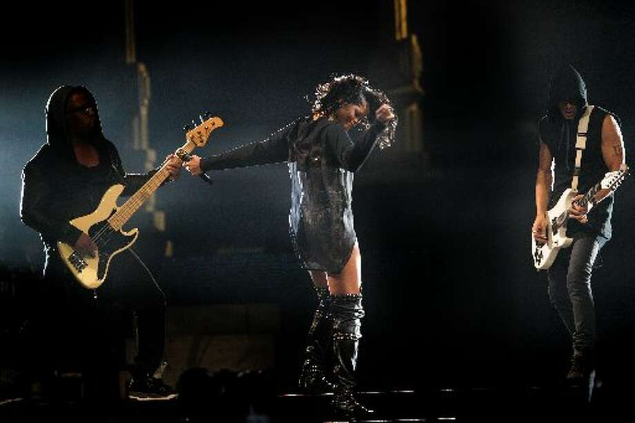 Rihanna performs during her Diamonds World Tour at the Toyota Center in Thursday, November 14, 1013 in Houston, TX. Photo: Billy Smith II, Chronicle