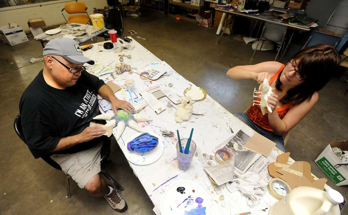 Andy Ledesma and Kaile Viator work on paper mache' art projects at the Art Studio in Beaumont, Thursday. Tammy McKinley/The Enterprise