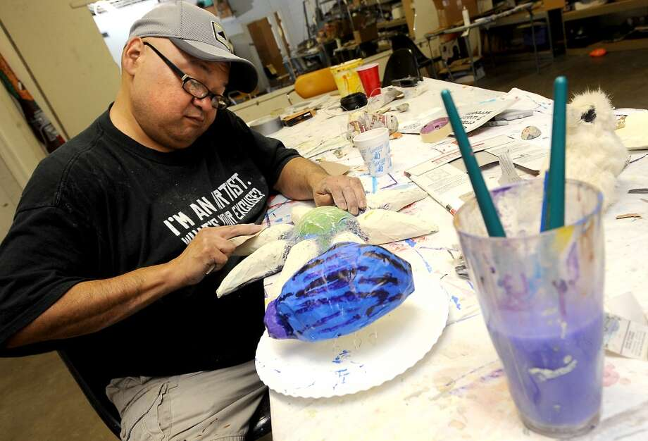 Andy Ledesma works on a paper mache' project at The Art Studio in Beaumont, Thursday. Tammy McKinley/The Enterprise