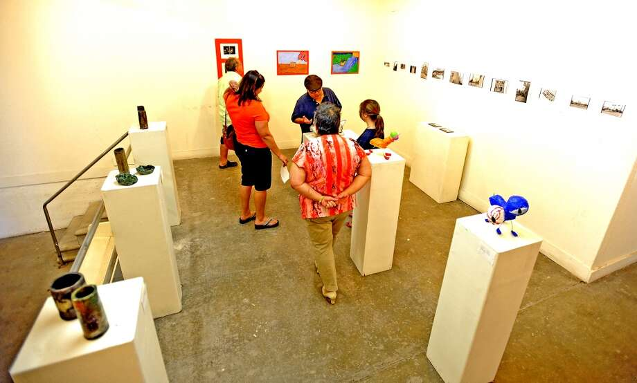 The Art Studio Inc. 'Art Skool' held its ending week show on Friday as a chance to show the students work for family and friends. Photo taken Friday, July 26, 2013. Photo taken: Randy Edwards/The Enterprise