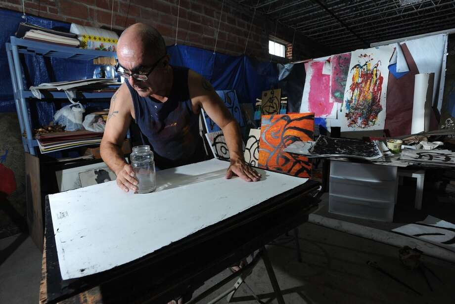 "Andy Coughlan prepares for, ""Caravanserai: A Solo Exhibition,"" which opens at the Art Studio on October 6 at 7 p.m. The event his showcase Coughlan's large-scale line drawings that celebrate the female form. Photo taken Wednesday, September 25, 2012 Guiseppe Barranco/The Enterprise Photo: Guiseppe Barranco/The Enterprise"
