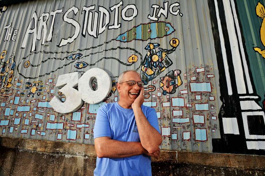 Greg Busceme, director of The Art Studio, Inc. stands in front of the TASi mural, Tuesday.The Art Studio, Inc. is celebrating its 30th birthday Nov. 16 with a massive 80s-themed party.  Michael Rivera/@michaelrivera88