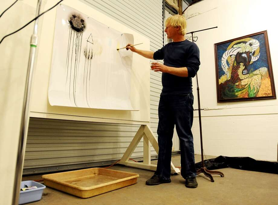 Local artist Sean Wilcox demonstrates his chemical painting process which Wilcox has been experimenting with over the past 20 years. This demonstration took place during a gallery talk at the Art Studio Inc. on Thursday, November 15, 2012. Photo taken: Randy Edwards/The Enterprise