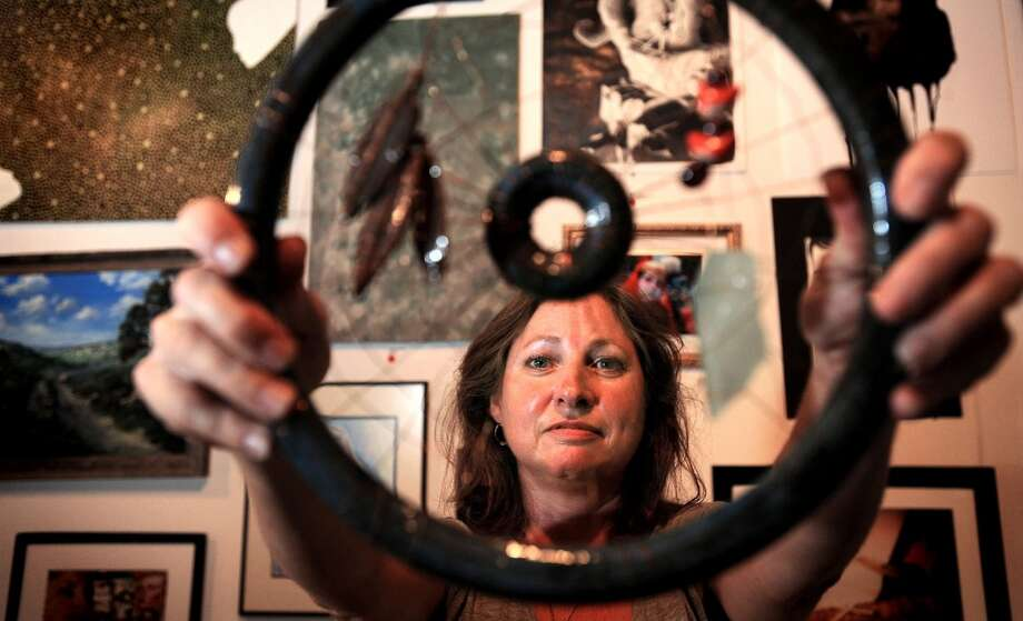 Cyndi Grimes displays Dreamcatcher at the Art Studio in Beaumont. Guiseppe Barranco/The Enterprise Photo: Guiseppe Barranco/The Enterprise
