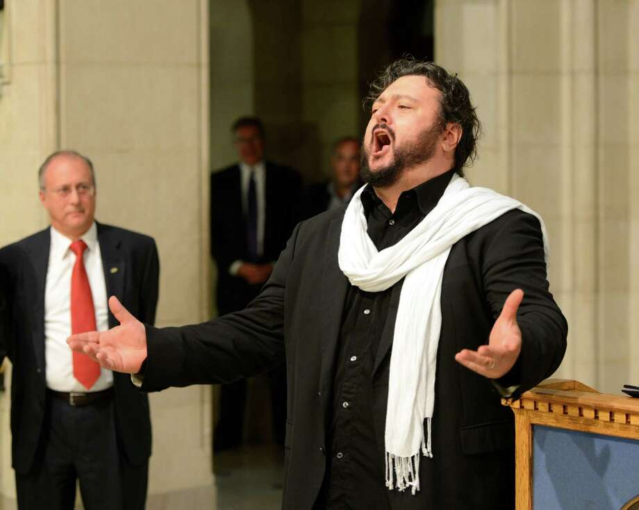 Italian tenor David Regheschi sings his thanks to the assembly at Albany City Hall in Albany.     (Skip Dickstein/Times Union) Photo: Skip Dickstein / 00019754A