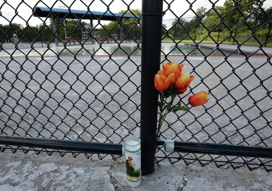 Flowers were placed at the fence of the Alice Keith Park after the drowning incident the left two people dead on Thursday.  Photo taken Friday, October 11, 2013.  Guiseppe Barranco/The Enterprise Photo: Guiseppe Barranco, Photo Editor