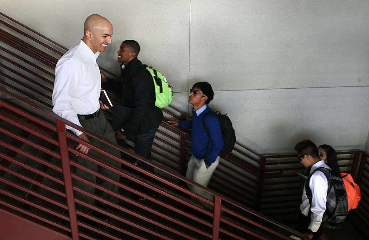 Republican Neel Kashkari (left) visits Eastside College Preparatory School in East Palo Alto, California on Friday, November 8, 2013. The 39-year-old former Bay Area Goldman Sachs banker oversaw the Troubled Asset Relief Program in two presidential administrations.