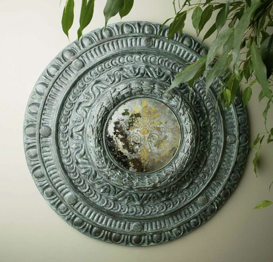 A synthetic medallion is an affordable and accessible detail to dress up a wall.