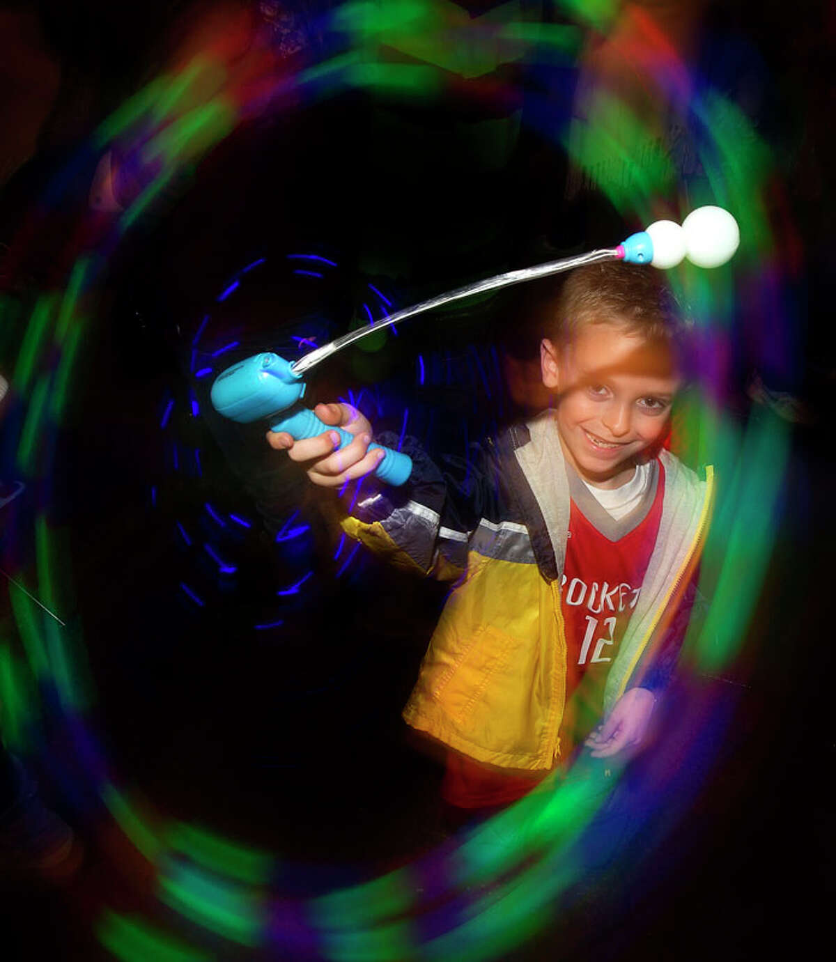 Cole Dobyanski spins his light toy around during New Year's Eve Houston held at Discovery Green on Monday, Dec. 31, 2012, in Houston. Cole is a New Years baby and will turn seven on Jan. 1.