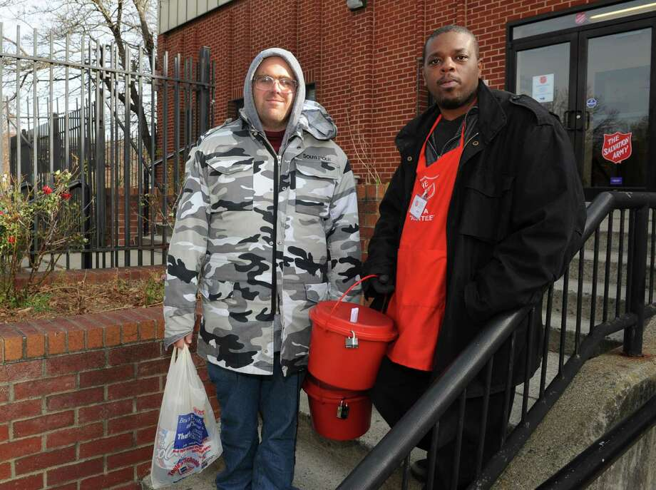 Salvation Army volunteers Edward Arusti, left, and Devon Morris, both of Albany, get ready to board a van and head to a location for the 2013 Annual Bell Ringing Campaign on Friday, Nov. 15, 2013, in Albany, N.Y.  (Lori Van Buren / Times Union) Photo: Lori Van Buren / 00024652A