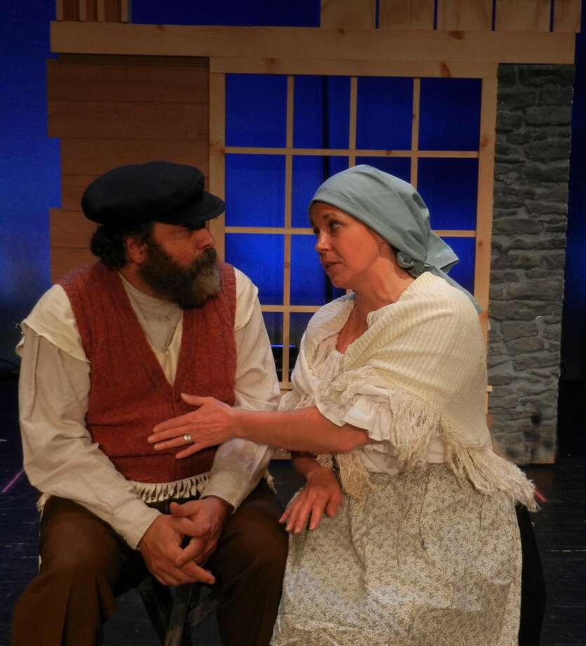 "Tevye, the dairyman, and his wife Golde, played by Lou Ursone of Stamford and Jacqueline MacLean of Stratford in a scene from Curtain Call's ""Fiddler on the Roof."" The musical begins three weekends of performances on Nov. 15, 2013 at the Stamford, Conn.-based theater company."