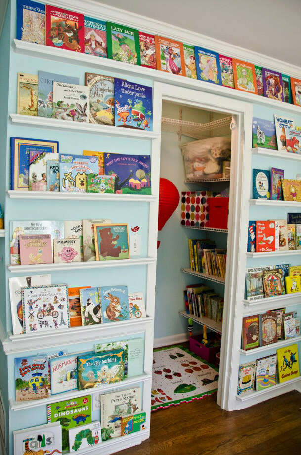 A book wall and reading nook for children can be fashioned from a former home office. Photo: Associated Press