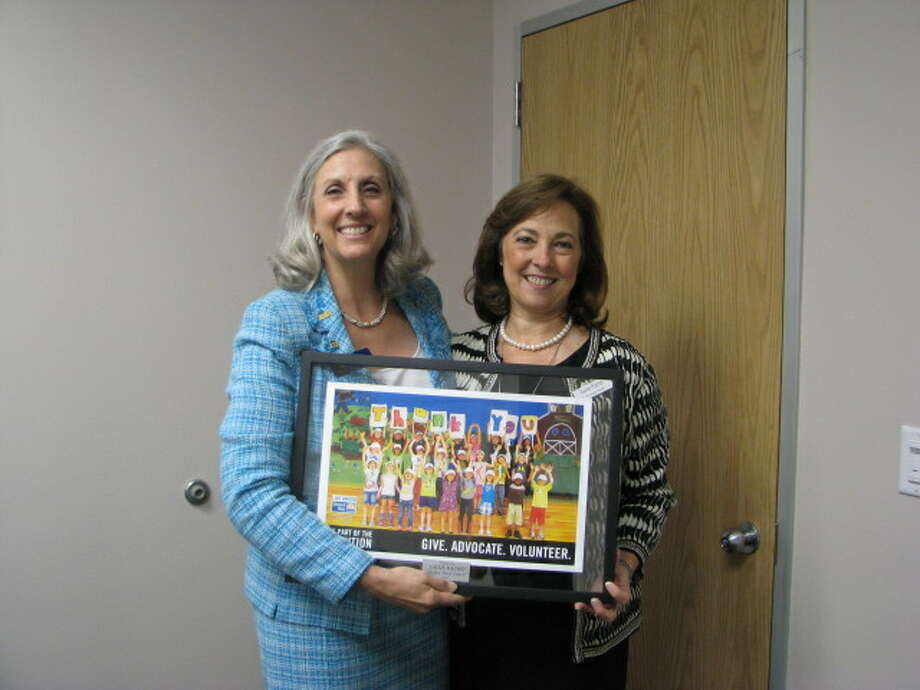Julie Martineau, left, and Sallie Rainer attend the first In Her Shoes Luncheon Oct. 23. Photo: Provided By Entergy