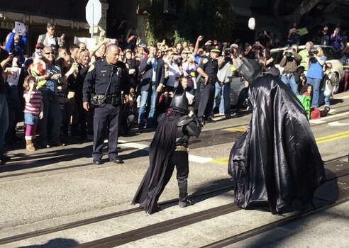 Batkid and his buddy Batman on their way to free the damsel in distress. Photo: The Chronicle / Vivian Ho