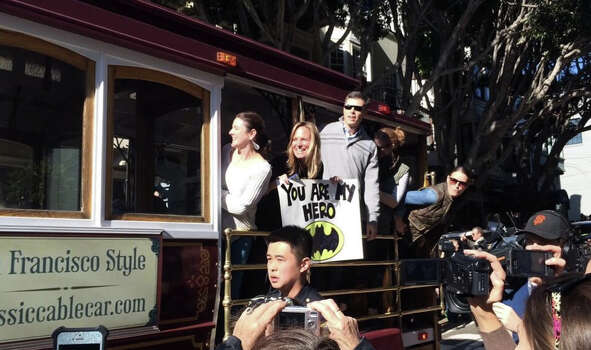 Batkid fans on a cable car hope to grab a peak of the caped crusader. Photo: The Chronicle / Vivian Ho