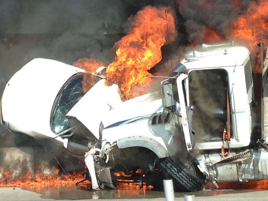 Two people died late Friday morning in a fiery, 3-vehicle crash on the Sam Houston Parkway in northwest Harris County. (Submitted by Cliff Moore) Photo: Submitted By Cliff Moore