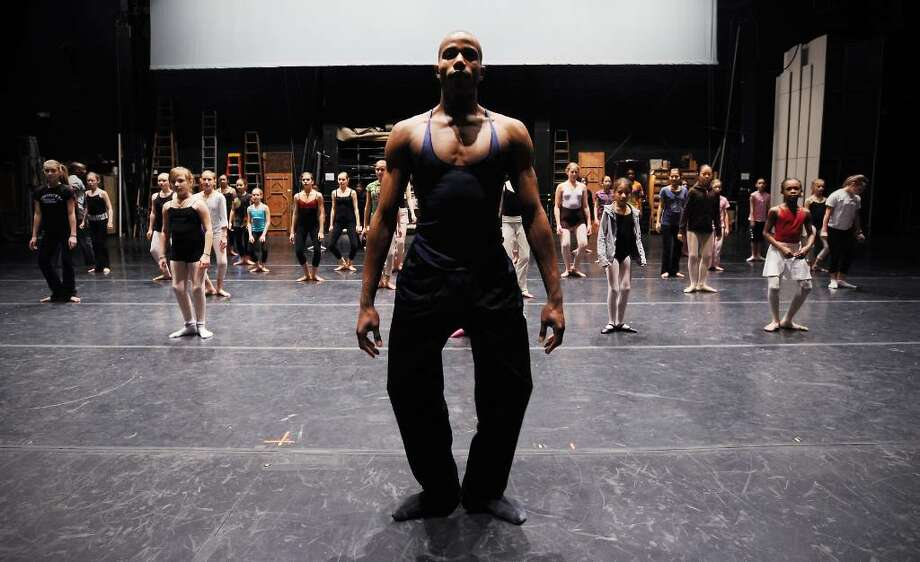Romero Patterson assists instructor Tracy Inman, of the Ailey School of NYC, with a modern dance master class during DanceFest 2010 at the Palace Theater in in Stamford, Conn. on Saturday, Jan. 23, 2010. Photo: Kathleen O'Rourke / Stamford Advocate