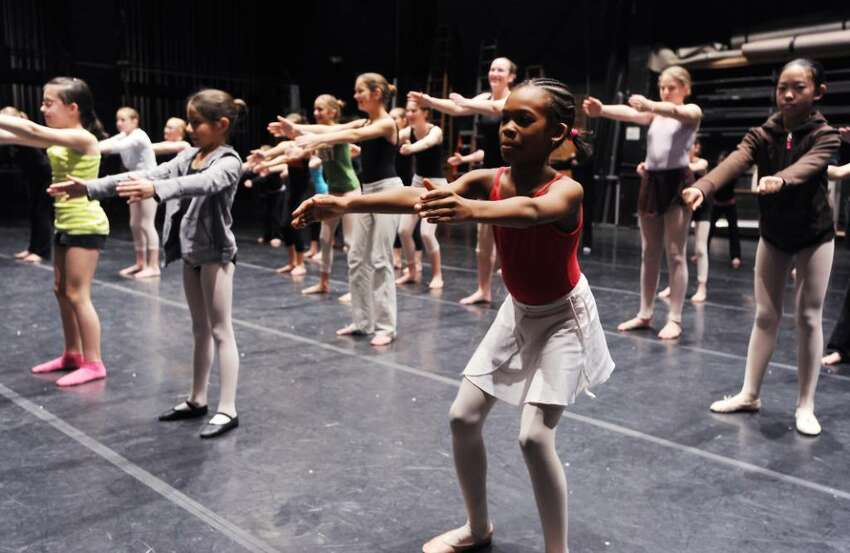 Dancers participate in a modern dance master class during DanceFest 2010 at the Palace Theater in Stamford, Conn. on Saturday, Jan. 23, 2010.