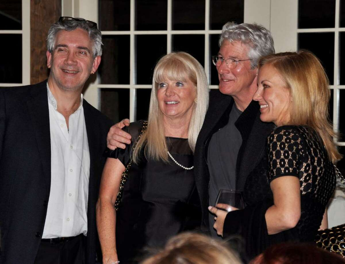 """From left, neurosurgeon Ezriel Kornel, Carol Bagen, a member of """"The Spirit of Green Chimneys"""" event committee, actor Richard Gere and artist Katherine Pettiti Kornel, a member of the event committee who offered 50 percent of the proceeds of her paintings displayed at the restaurant to Green Chimneys."""