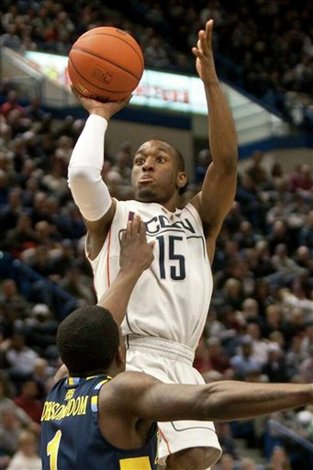 Connecticut's Kemba Walker shoots over Marquette's Darius Johnson-Odom during first half of an NCAA college basketball game in Hartford, Conn., on Saturday, Jan. 30, 2010. Photo: AP/Thomas Cain