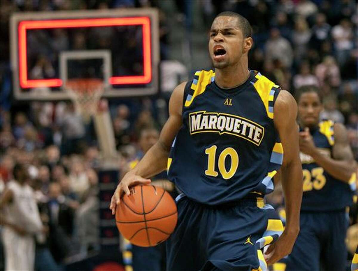 Marquette's David Cubillan reacts after intercepting a Connecticut pass to end the game in their 70-68 win in an NCAA college basketball game in Hartford, Conn., on Saturday, Jan. 30, 2010.