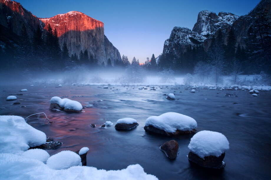 "Yosemite National Park: Ditch the crowds during the park's slower, ""snow-laden winter months,"" says National Geographic's ""Four Seasons of Travel.""  Photo: Joseph Ganster, Getty Images / © 2013 Joe Ganster"