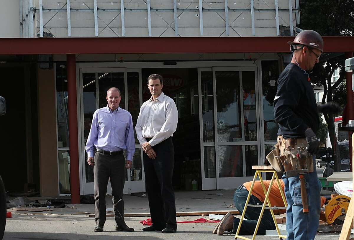 Co-CEO's MacGregor Read (middle left) and Eric Lindberg Jr. (middle right) visit the new Grocery Outlet under construction on Geary St. in San Francisco, California, on Monday, November 11, 2013. This will be the 202nd Grocery Outlet store which will be opening next week.