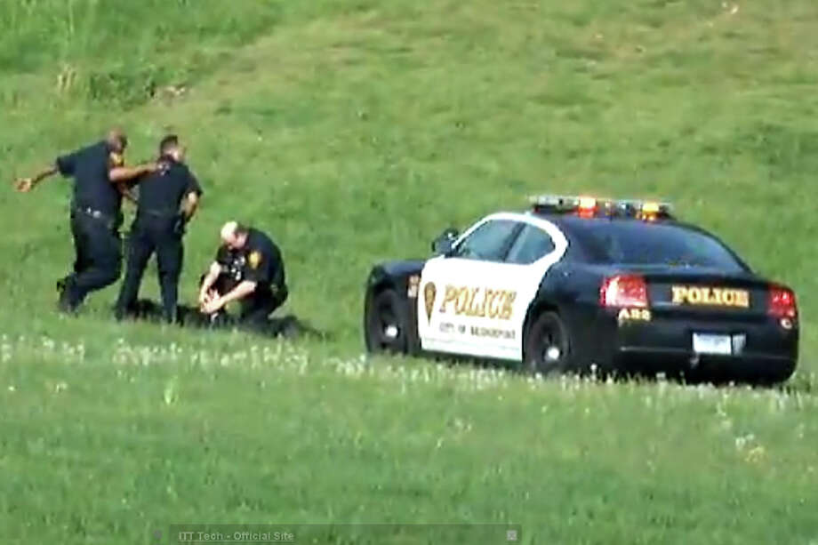 A screen grab from a video, posted on YouTube on Jan. 6, 2013, showing three Bridgeport, Conn. police officers kicking a man in Beardsley Park on May 20, 2011. Officers Elson Morales, Joseph Lawlor  and Clive Higgins were put on the paid administrative leave Jan.18, 2013 pending an investigation of the incident by the city's Office of Internal Affairs. The man, who has not been identified, is lying on the ground after being Tasered by one of the officers when two of the officers begin kicking him. A third officer then gets out of his patrol car and walks over to where the other two are still kicking the man and then he too begins kicking him. Photo: Contributed Photo / Connecticut Post Contributed