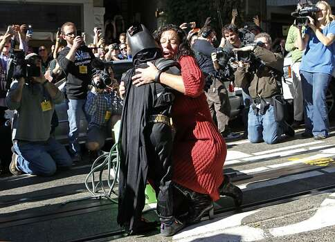 Sue Graham Johnston with a big hug of thanks to five year old Miles as Batkid after being rescued along the Hyde Street cable car line in San Francisco Ca., on Friday Nov. 15, 2013.  Five year old Miles from Tulelake in Siskiyou County loves superheroes and Batman in particular. After battling leukemia since he was a year old Miles will fulfill his dream of becoming Batkid being swept around the city performing superhero feats from rescuing a damsel in distress to thwarting a bank robbery and even chasing down the Penguin through AT&T Park Photo: Michael Macor, The Chronicle