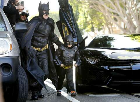 Batman and five year old Miles as Batkid arrive on the scen of a report of a damsel in distress along the Hyde Street cable car line in San Francisco Ca., on Friday Nov. 15, 2013.   Five year old Miles from Tulelake in Siskiyou County loves superheroes and Batman in particular. After battling leukemia since he was a year old Miles will fulfill his dream of becoming Batkid being swept around the city performing superhero feats from rescuing a damsel in distress to thwarting a bank robbery and even chasing down the Penguin through AT&T Park Photo: Michael Macor, The Chronicle