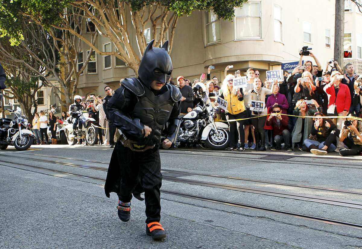 Believe it or not, it's been two years since Miles the Batkid entered our lives and made San Francisco a kinder, happier place. Here are some of our favorite pictures from that magical day. We hope it brightens your day as much as it brightened ours.   Miles as Batkid runs to the scene of a report of a damsel in distress along the Hyde Street cable car line in San Francisco Ca., on Friday Nov. 15, 2013.